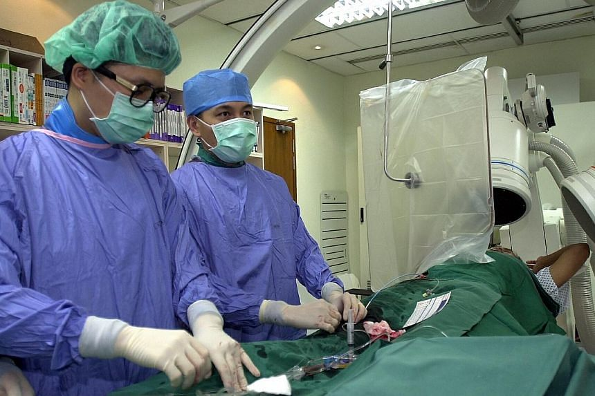 The total operation fees for 65 common procedures will be published by the Ministry of Health (MOH) on its website from Monday. These procedures account for more than two-thirds of all procedure-related admissions. -- PHOTO: ST FILE