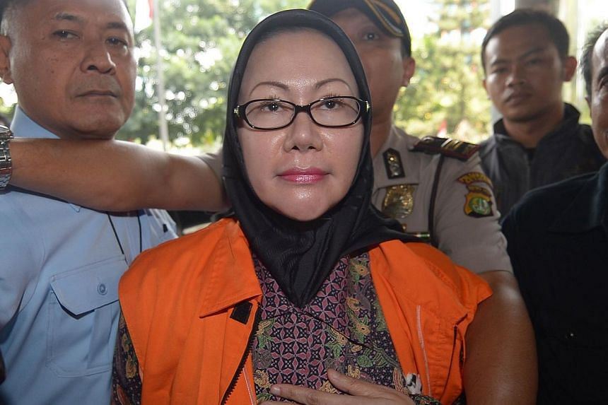 Indonesian Ratu Atut Chosiyah arrives at a court prior to her trial in Jakarta on Sept 1, 2014. -- PHOTO: AFP