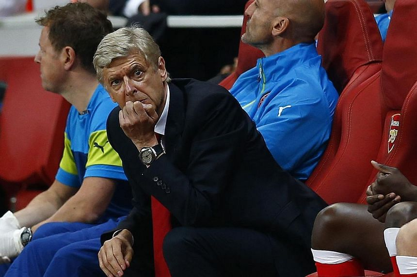 Arsenal manager Arsene Wenger reacts during their Champions League playoff football match against Besiktas at the Emirates stadium in London on Aug 27, 2014.-- PHOTO: REUTERS