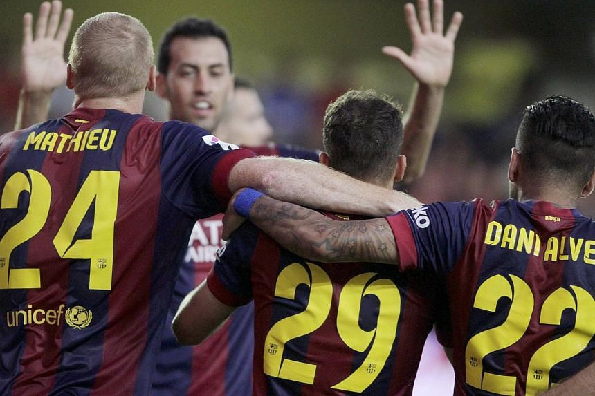 Barcelona's players celebrate after Sandro Ramirez (2nd right) scored against Villarreal during their Spanish first division soccer match at the Madrigal stadium in Villarreal August 31, 2014. -- PHOTO: REUTERS