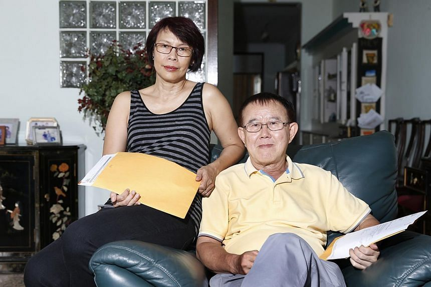 Mr and Mrs Hey Bong Koi with their Lasting Power of Attorney and Advance Medical Directive documents. Mr Hey saw the urgency of making an LPA after a stressful experience dealing with his parents' assets.