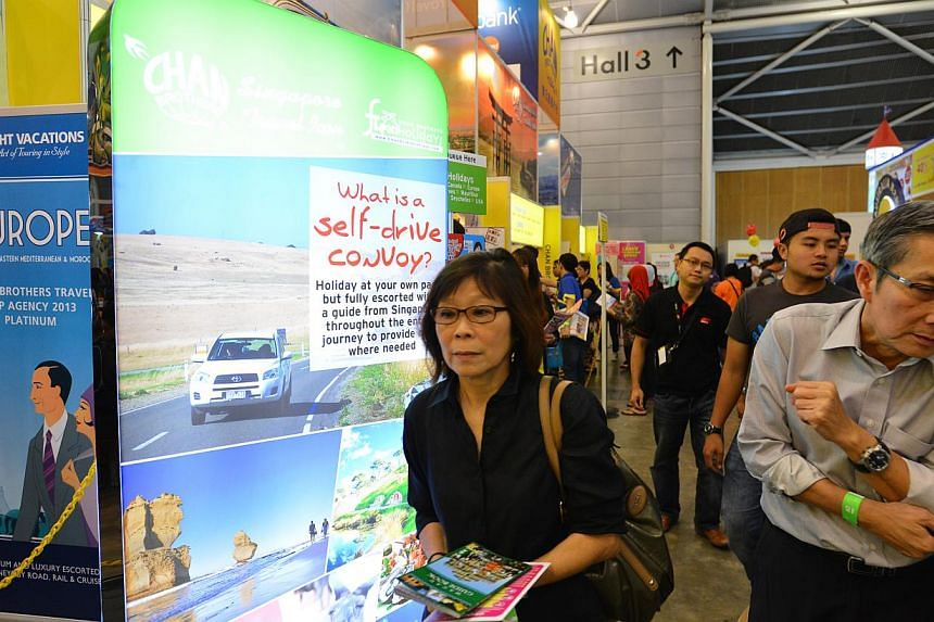 Visitors at Chan Brothers' booth at the recent Natas Holidays fair. The agency says the number of bookings for self-drive holidays so far this year has risen 30 per cent over last year's figure.