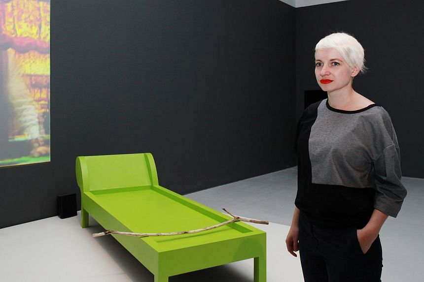 Curator Anca Rujoiu (above) with Joan Jonas' multimedia installation Lines In The Sand (2002) and Isaac Julien's video installation Vagabondia (2000). -- PHOTO: CENTRE FOR CONTEMPORARY ART