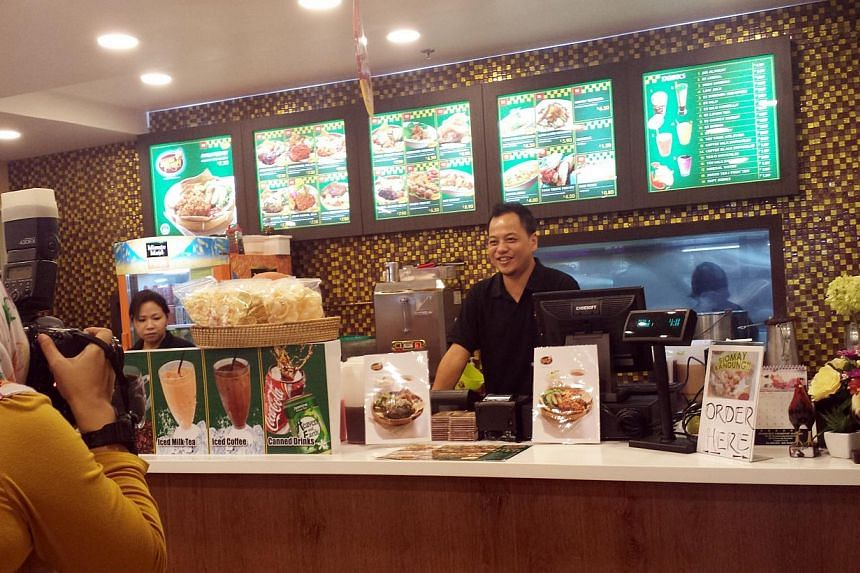 Mr Edy at one of his food outlets in Singapore. He now has 11 Dapur Penyet outlets in places like Clementi and Tiong Bahru.