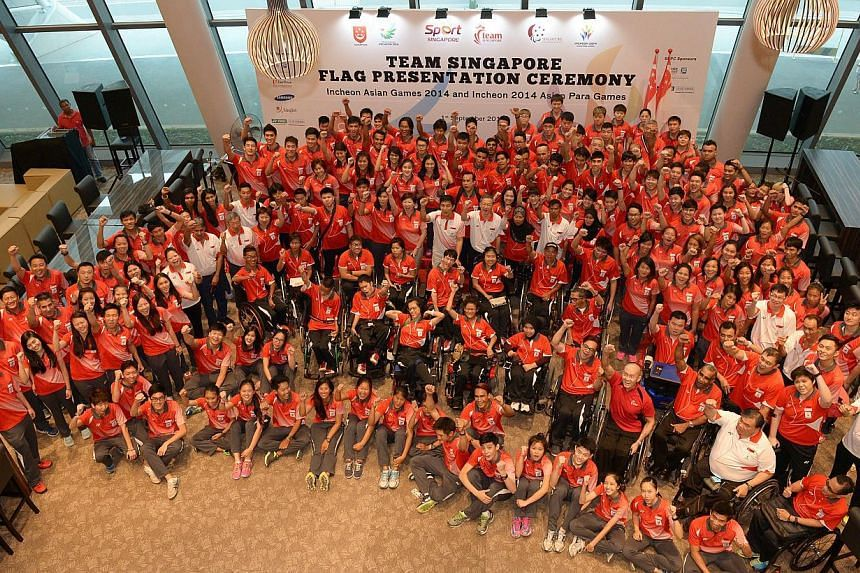 The over 300-strong team Singapore with Mr Tan Chuan-Jin, Minister for Manpower and president of the Singapore National Olympic Council, after theTeam Singapore flag presentation for the contingents representing our nation at the upcoming Asian