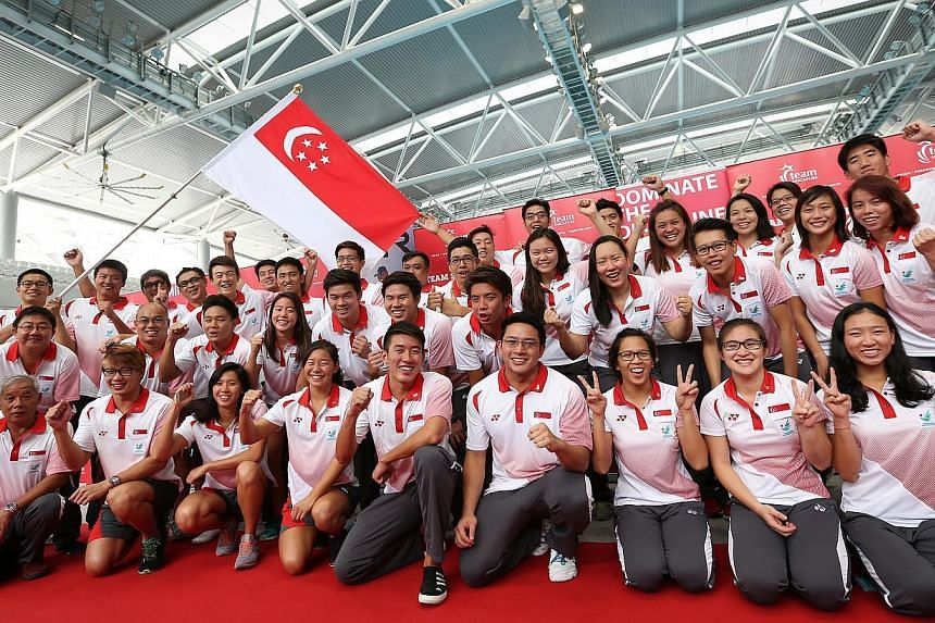 The Singapore Swimming Association organises a send off ceremony for our aquatic athletes who will be representing Singapore at the Asian Games 2014 in swimming, water polo and diving. -- ST PHOTO: NEO XIAOBIN
