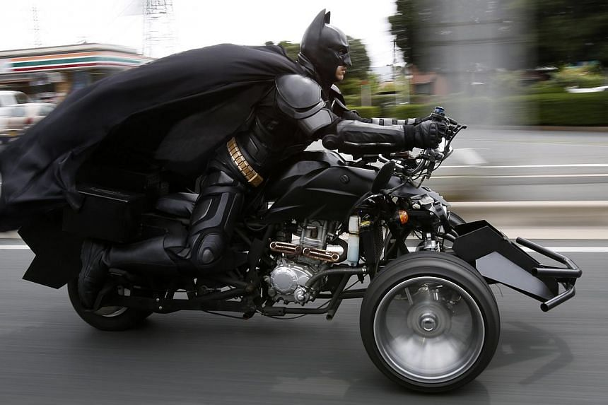 "A 41-year-old man going by the name of Chibatman rides his ""Chibatpod"" on the road in Chiba, east of Tokyo, on Aug 31, 2014.  -- PHOTO: REUTERS"