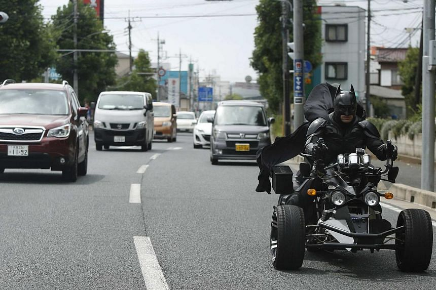 On the road in Chiba, east of Tokyo. -- PHOTO: REUTERS