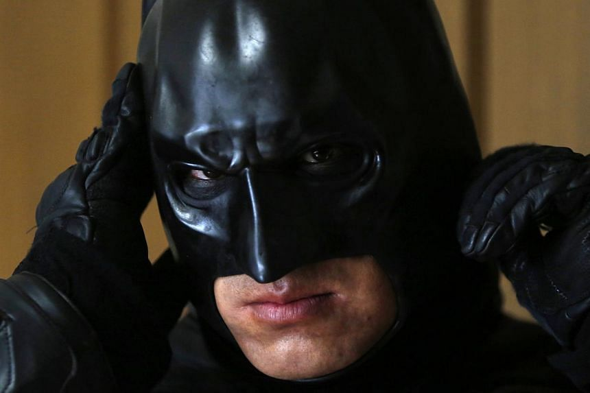 Chibatman adjusting his mask before going out to meet the good citizens of Chiba. -- PHOTO: REUTERS