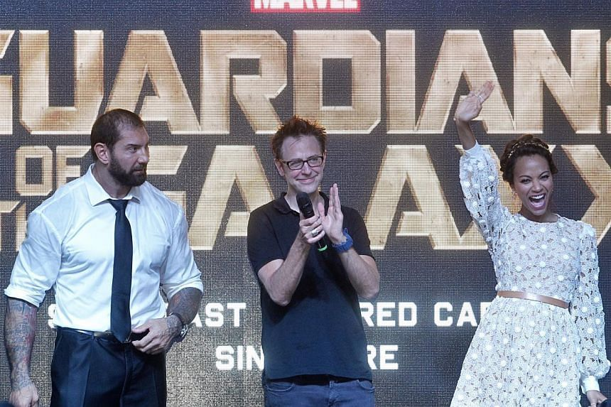 (From left) WWE wrestler Bautista, director James Gunn and Zoe Saldana were in Singapore to promote their movie, Guardians Of The Galaxy. -- PHOTO: ST FILE