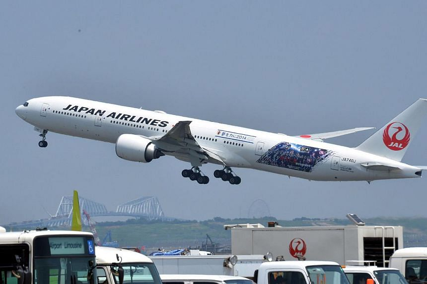 Japan Airlines (JAL) passenger jet taking off at Haneda airport in Tokyo. -- PHOTO: AFP