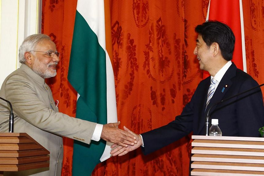 Indian Prime Minister Narendra Modi (left) shakes hands with Japanese Prime Minister Shinzo Abe after a joint press conference at Akasaka State Guest House in Tokyo on Sept 1, 2014. -- PHOTO: AFP