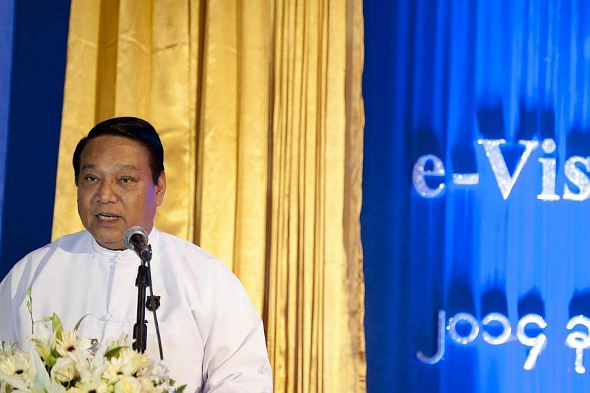 Myanmar Minister of Immigration and Population U Khin Yi speaks during the opening ceremony of an online electronic E-Visa system in Yangon. -- PHOTO: AFP