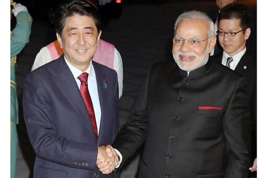 India's new Prime Minister Narendra Modi (front right) is welcomed by his Japanese counterpart Shinzo Abe upon his arrival at the State Guest House in Kyoto, western Japan, on Aug 30, 2014. -- PHOTO: AFP