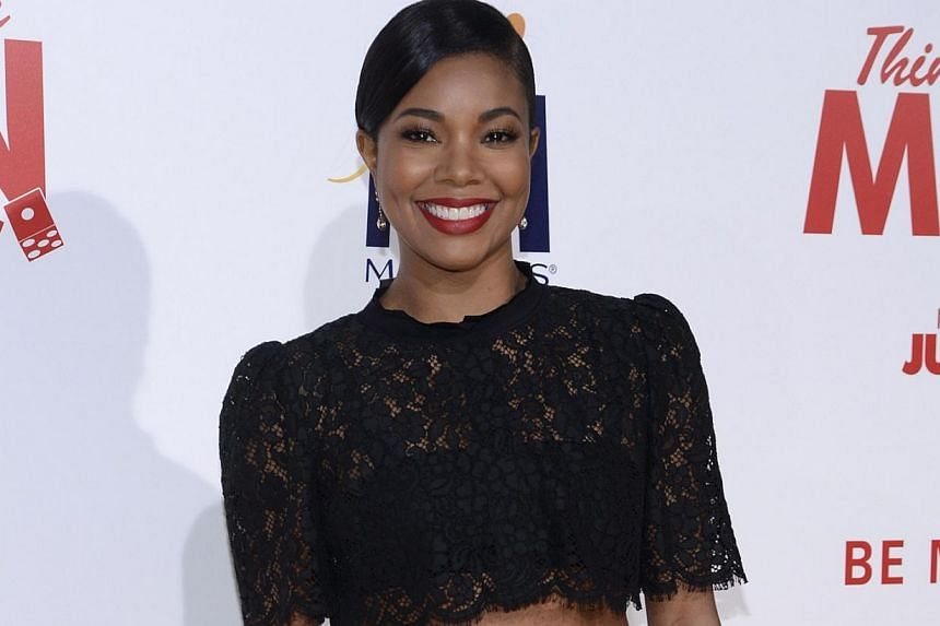 "Cast member Gabrielle Union attends the premiere of ""Think Like a Man Too"" in Los Angeles on June 9, 2014. She was one of several stars to have nude photos leaked on social media in a recent hacking leak. -- PHOTO: REUTERS"