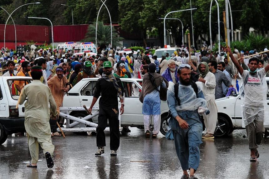 Pakistani opposition protesters gather during clashes with police near the prime minister's residence in Islamabad on Sept 1, 2014. -- PHOTO: AFP