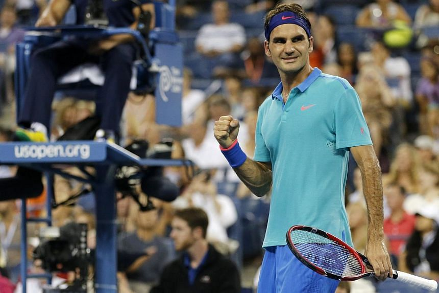 Roger Federer of Switzerland celebrates after defeating Marcel Granollers of Spain in the men's singles play following their match at the 2014 US Open tennis tournament in New York, on Aug 31, 2014. -- PHOTO: REUTERS