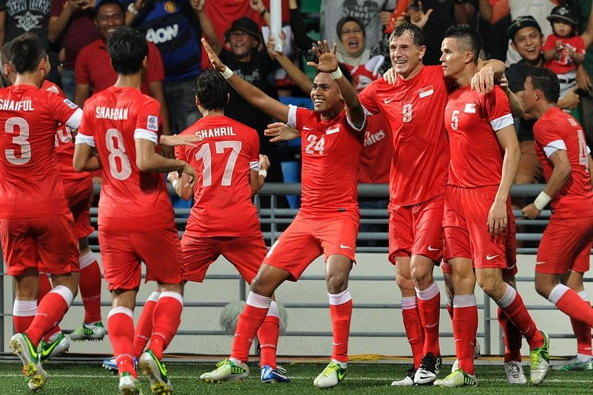 The Singapore football team celebrating Bhaihakki Khaizan's goal during the first leg match of the AFF Suzuki Cup final held at the Jalan Besar Stadium on Dec 19, 2012. The Singapore national football team will face Papua New Guinea and Hong Kon