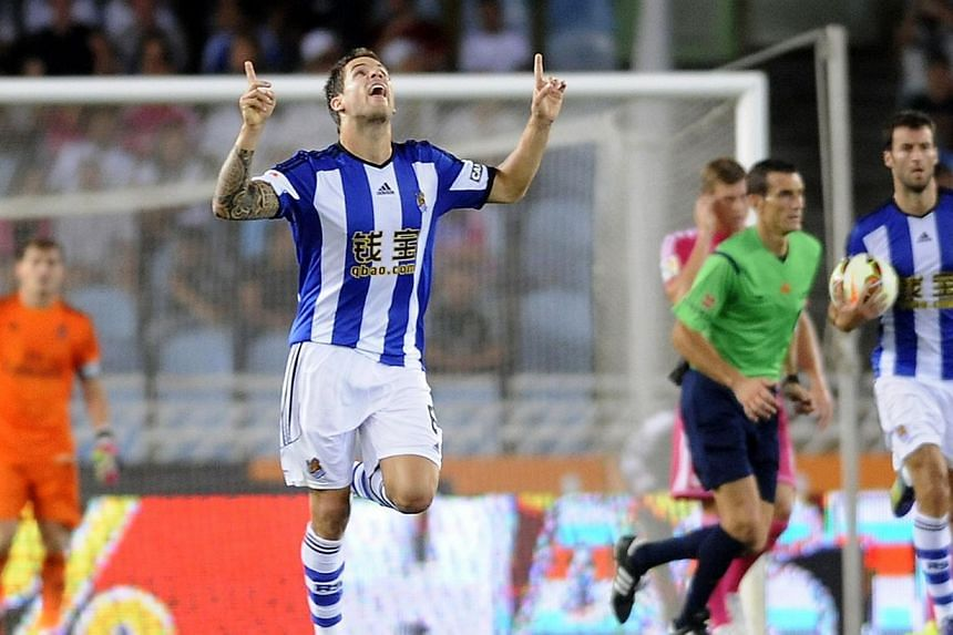 Real Sociedad's defender Inigo Martinez celebrates after scoring his team's first goal during the Spanish league football match against Real Madrid at the Anoeta stadium in San Sebastian on August 31, 2014. -- PHOTO: AFP