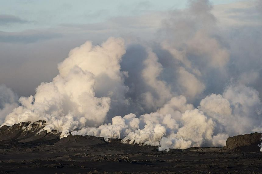 Steam and smoke rise over a 1-km-long fissure in a lava field north of the Vatnajokull glacier, which covers part of Bardarbunga volcano system, on Aug 29, 2014. -- PHOTO: REUTERS