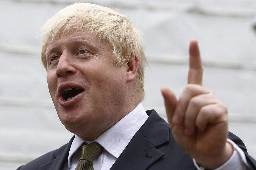 London Mayor Boris Johnson speaks to members of the media after giving a speech on the European Union, in London on Aug 6, 2014. A plan to build a major new airport to the east of London was rejected by a government-appointed commission on Tuesd