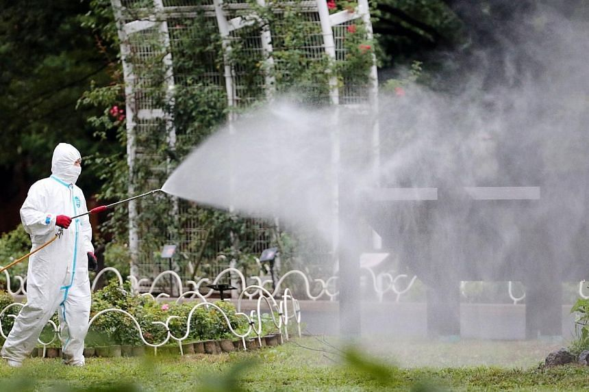 A worker spraying insecticide at Yoyogi Park, one of the largest open spaces in central Tokyo, which is believed to be the source of the mosquito-borne dengue fever.A worsening outbreak of dengue fever in Japan has claimed its first celebrities