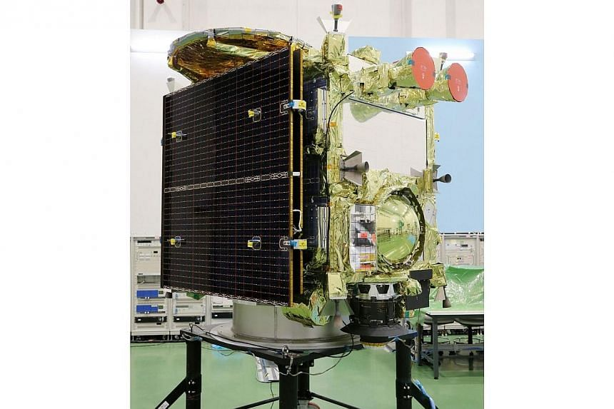 This picture taken on Aug 31, 2014, shows the new asteroid explorer Hayabusa-2 during the space probe's unveiling for the press at the Japan Aerospace Exploration Agency (JAXA) facility in Sagamihara, suburban Tokyo.-- PHOTO: AFP
