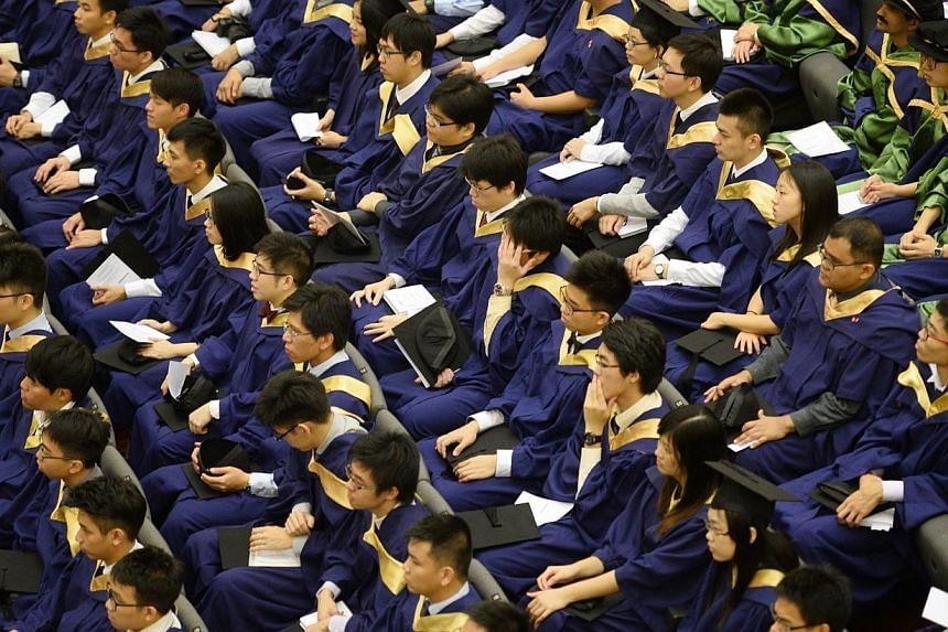 """National University of Singapore (NUS) graduates attending their Commencement ceremony on July 7, 2014. The abundance of higher education means that a degree is not quite the """"one-way ticket to success"""" it once was, Deputy Prime Minister Teo Chee Hea"""