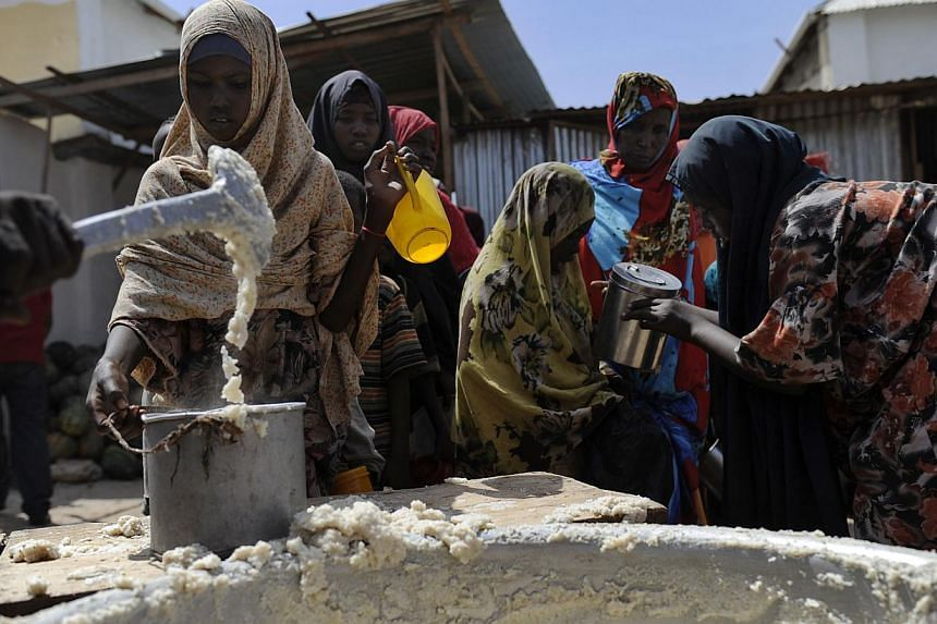 A file picture taken on Jan 19, 2012, shows displaced Somalis queueing as they wait for food-aid rations at a distribution centre in the capital Mogadishu.Over a million people in war-torn Somalia are struggling in conditions close to famine, w