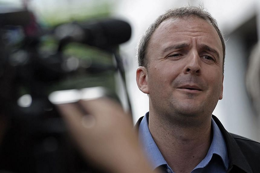 British activist Andy Hall answers reporters' questions as he arrives for a hearing at a court in Bangkok on Sep 2, 2014.-- PHOTO: AFP