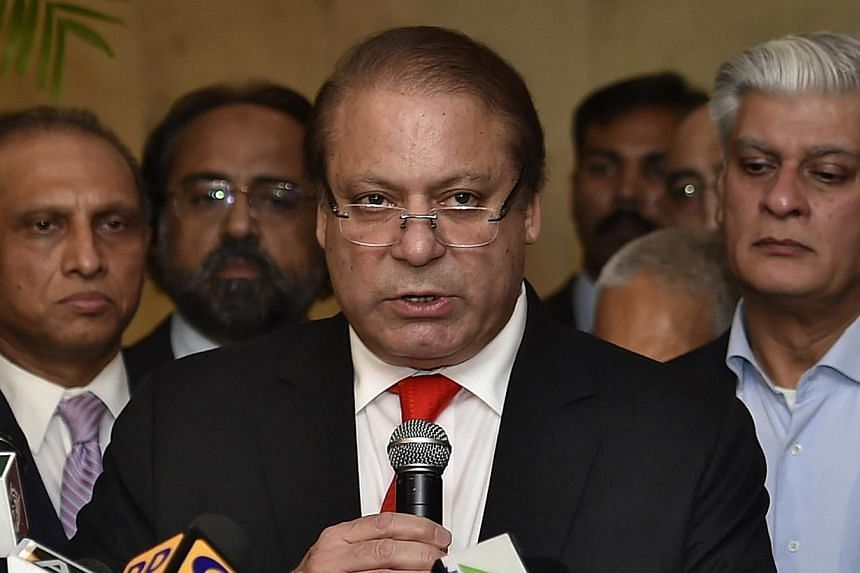 Pakistan's Prime Minister Nawaz Sharif speaks with the media during a news conference in New Delhi on May 27, 2014.Pakistan's parliament threw its weight behind embattled Prime Minister Nawaz Sharif on Tuesday as a deepening crisis over violent