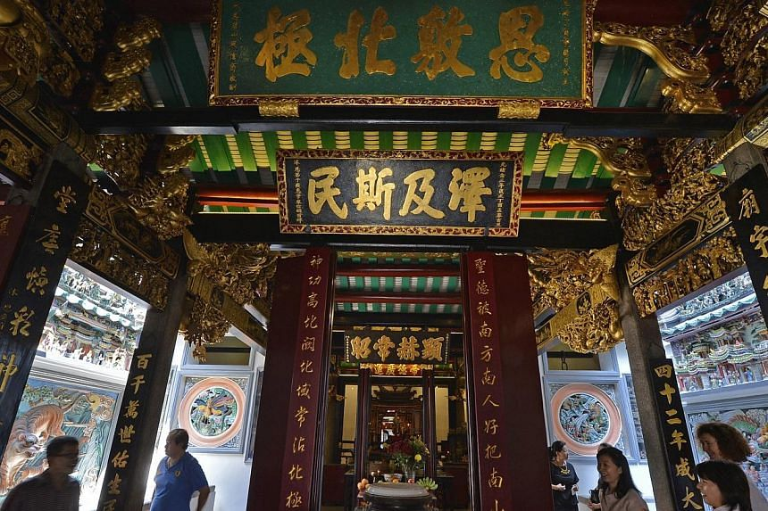 The temple's gold gilding has been conserved, its timber structure restored and its once-dark prayer halls now infused with gentle lighting. This is one of the two shrines it houses. -- PHOTO: ST FILE