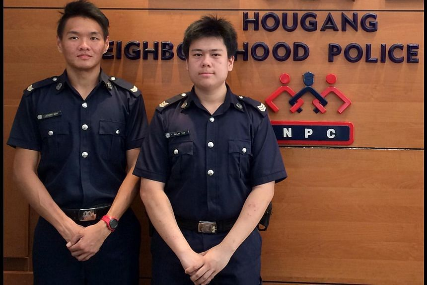 Voluntary Special Constable Corporal Jeremy Koh (left) and Special Constable Sergeant Allan Tay initially questioned the suspect for fighting.
