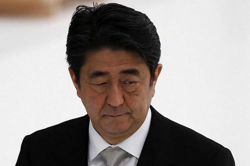 """Prime Minister Shinzo Abe's plan for Japan's economy to generate self-sustained growth on the back of his three policy """"arrows"""" of massive monetary easing, spending and reform appears to be faltering - but no magic solution is in sight.-- PHOTO: REUT"""