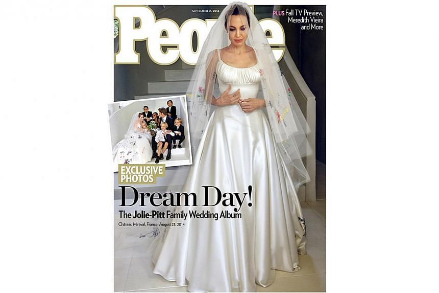 Angelina Jolie walked down the aisle in a wedding dress decorated with designs taken from her six children's artworks. People magazine's latest cover shows the actress in a simple, white satin gown filled with the colourful images of their drawings.