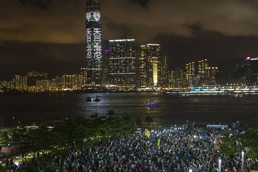 Pro-democracy protesters hold up their mobile phones during a campaign to kick off the Occupy Central civil disobedience event in Hong Kong. -- PHOTO: REUTERS