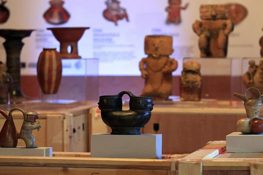 Colombian archaeological pieces are displayed as part of an exhibition at a media preview at the Foreign Ministry building in Bogota on Sept 1, 2014. -- PHOTO: REUTERS
