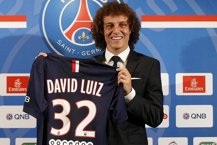 David Luiz of Brazil poses with his new Paris St Germain team jersey after a news conference at the Peninsula Paris luxury hotel in Paris, on Aug 7, 2014. -- PHOTO: REUTERS