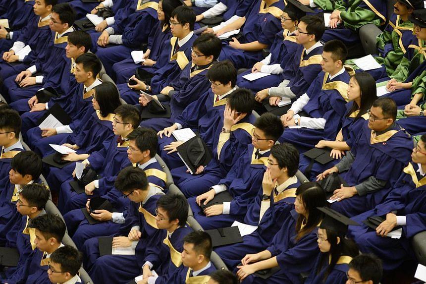 National University of Singapore (NUS) graduates attending their National University of Singapore (NUS) Commencement ceremony on July 7, 2014. -- PHOTO: ST FILE