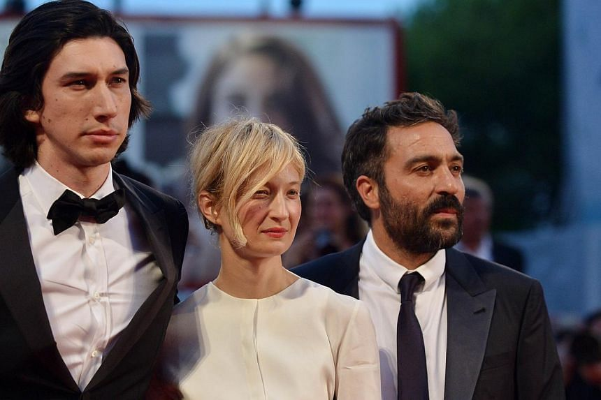 """Italian director Saverio Costanzo (right), Italian actress Alba Rohrwacher and US actor Adam Driver arrive for the screening of the movie """"Hungry Hearts"""" presented in competition at the 71st Venice Film Festival at Venice Lido on Aug 31, 2014. -- PHO"""
