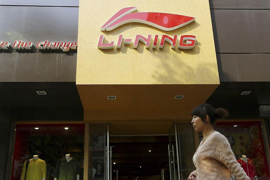 A woman walks past a Li Ning sportswear store in Huaibei, Anhui province in this Oct 17, 2012 file picture. -- PHOTO: REUTERS