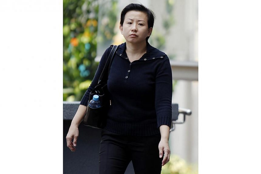 Ngoa Choi Yinwas jailed for 12 weeks on Tuesday after being convicted of five maid abuse charges - including biting the helper's finger.-- ST PHOTO:WONG KWAI CHOW