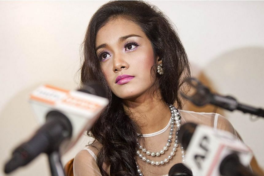 May Myat Noe, winner ofthe Seoul-based Miss Asia-Pacific World beauty pageant in May, talks to the media during a press conference in Yangon. -- PHOTO: AFP