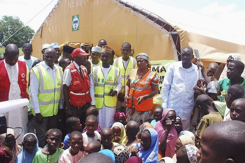 Refugees gather in an internally displaced persons (IDP) camp, that was set up for Nigerians fleeing the violence committed against them by Boko Haram militants, at Wurojuli, Gombe State on Sept 1, 2014. -- PHOTO: REUTERS