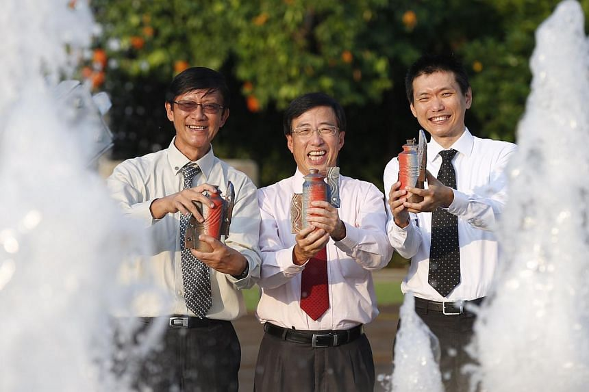 President's Award for the Environment recipients (from left) Waterways Watch Society chairman Eugene Heng, ITE CEO and director Bruce Poh and Ngee Ann Polytechnic principal Clarence Ti at the Istana on Sept 2, 2014. -- ST PHOTO: KEVIN LIM