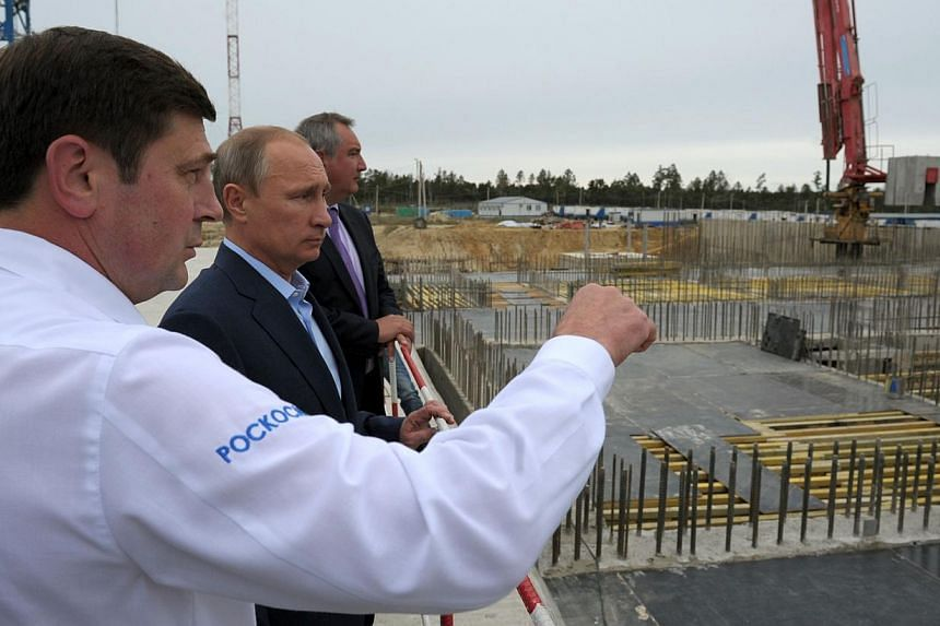 Russian President Vladimir Putin (second from left) listening to head of the Russian Space Agency Oleg Ostapenko (left) during a visit to the Vostochny Cosmodrome near the town of Uglegorsk on September 2, 2014. Mr Putinon Tuesday ordered const