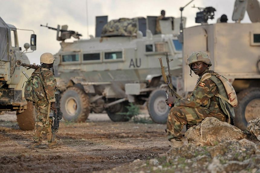 A handout picture taken on Aug 31, 2014 by the African Union-United Nations Information Support Team shows Ugandan soldiers, as part of the African Union Mission in Somalia, resting in the town of Kurtunwaarey in the Lower Shabelle region of Somalia