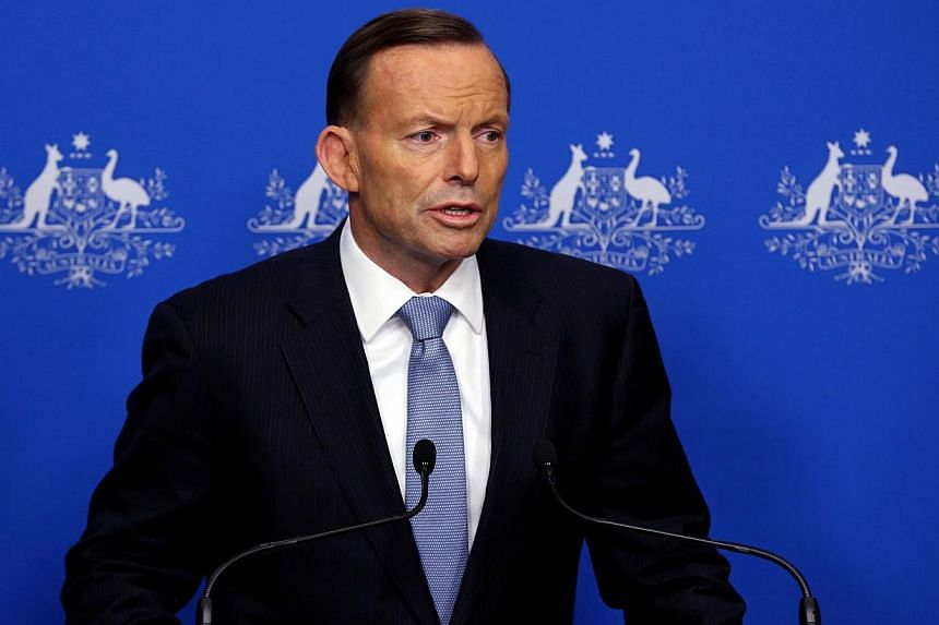 """Prime Minister Tony Abbott on Tuesday said """"extreme force"""" was justified in battling Islamic State militants as he played down reports that an Australian plane delivering humanitarian aid in Iraq came under fire. -- PHOTO: AFP"""
