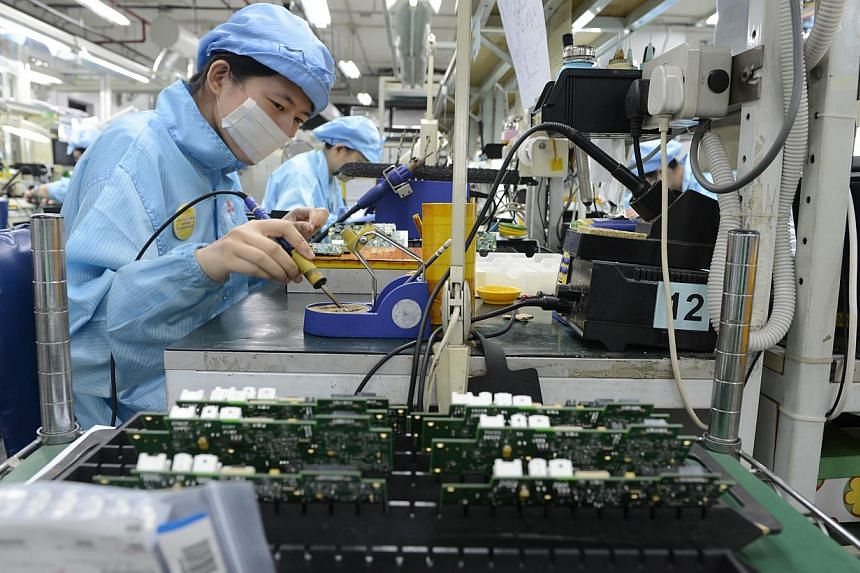 Hopes that the downbeat manufacturing sector had turned a corner were dashed on Tuesday, with new figures showing that factory activity unexpectedly shrank in August in its worst showing this year. -- PHOTO: ST FILE