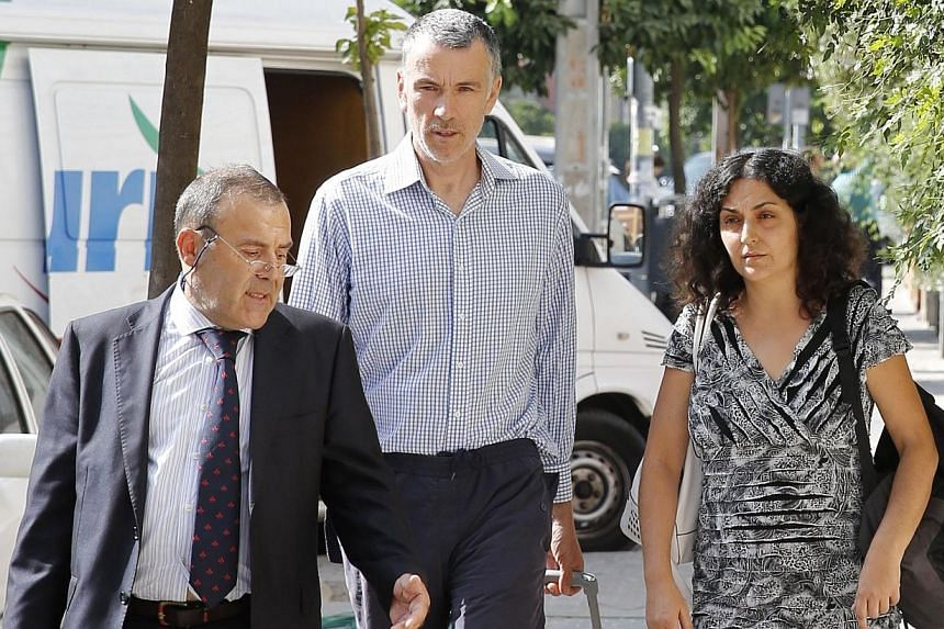 Naghemeh (right) and Brett King (centre), parents of Ashya King, walk before attending a news conference with their lawyer Juan Isidro Fernandez (right) in the Andalusian capital of Seville, Sept 3, 2014.British boy Ashya King is due to receive